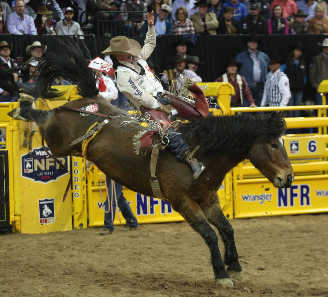 Clayton Biglow of Clements, Calif. rides Showstomper during Bareback Riding in the eighth go-ro ...