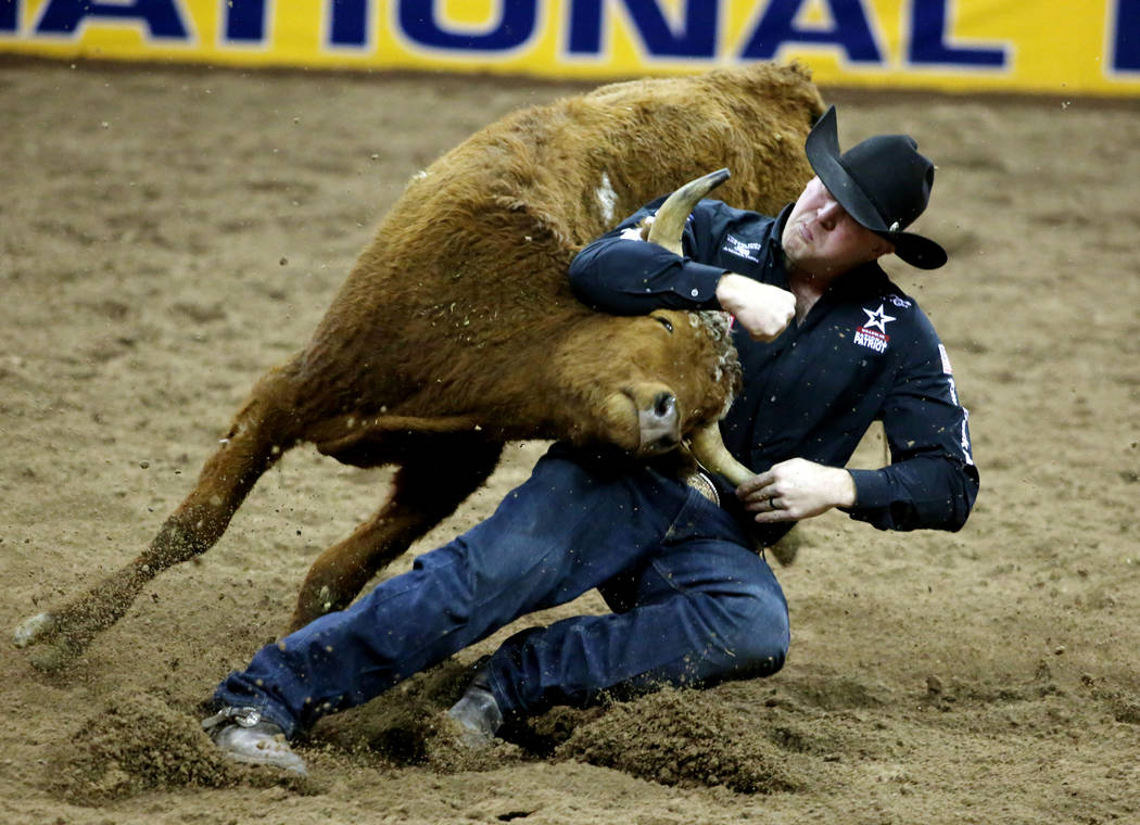 Will Lummus of West Point, Miss. competes in Steer Wrestling during Bareback Riding in the eigh ...