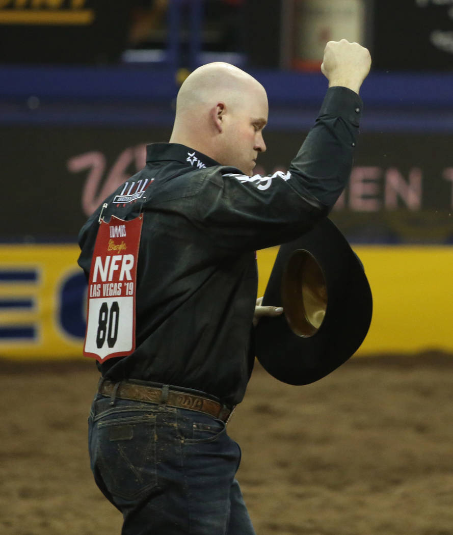 Will Lummus of West Point, Miss. celebrates his score after Steer Wrestling during Bareback Rid ...