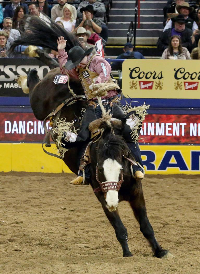 Jake Watson of Hudson Hope, British Columbia rides Stampede Warrior during Saddle Bronc Riding ...