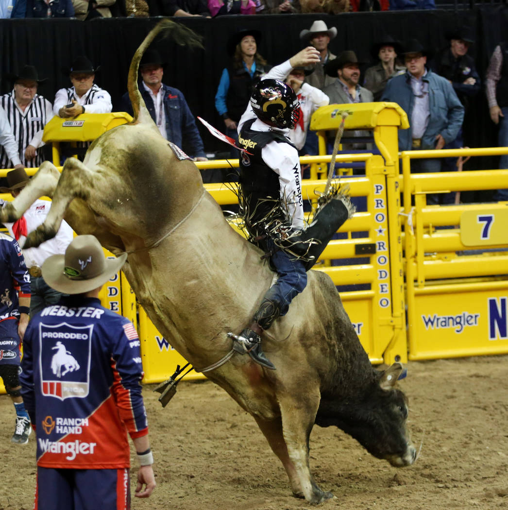 Sage Kimzey of Strong City, Okla. rides SweetPro's Bruiser during Bull Riding in the eighth go ...