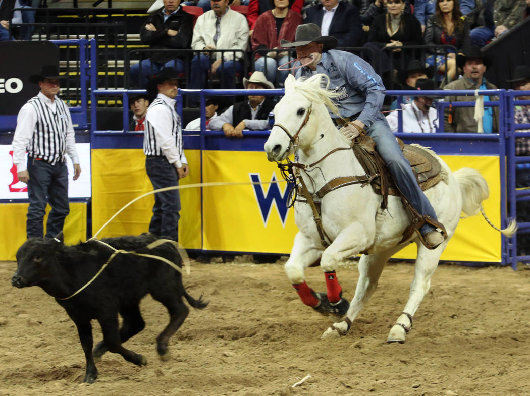 Riley Pruitt of Gering, Neb. competes in Tie-down Roping in the eighth go-round of the Wrangler ...