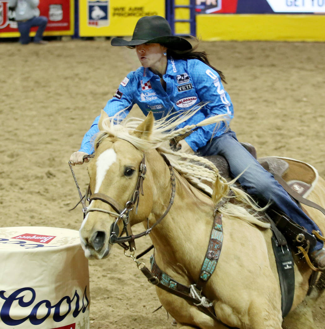 Hailey Kinsel of Cotulla, Texas competes in Barrel Racing in the eighth go-round of the Wrangle ...