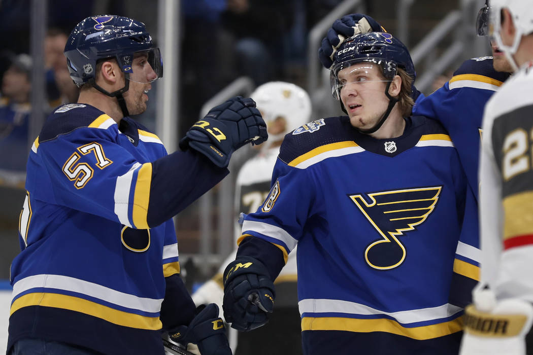 St. Louis Blues' Robert Thomas, right, is congratulated by David Perron (57) after scoring duri ...