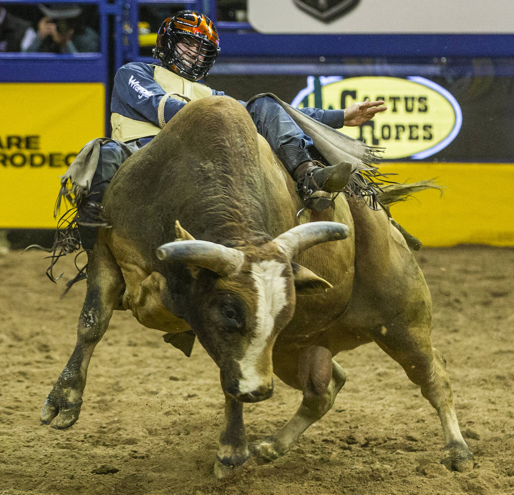 Trey Kimzey of Strong City, Okla., fights to stay on the back of Shootin' Stars in Bull Riding ...
