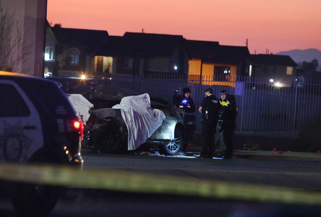 Metropolitan Police Department officers investigate after two people died in a two-vehicle cras ...