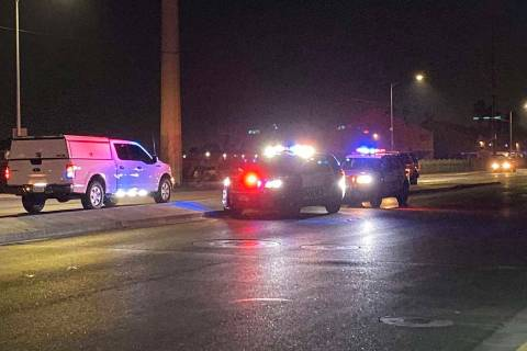 Police units block traffic near East Lake Mead Boulevard and North Pecos Road after a two-vehic ...