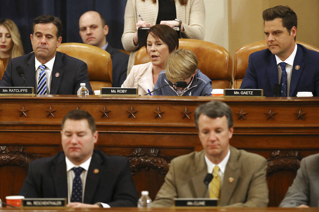 House Judiciary Committee member Rep. Martha Roby, R-Alabama, with her son George in her lap, v ...