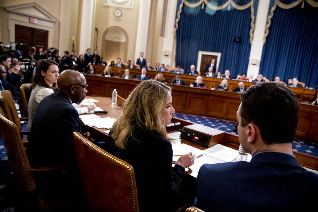 Madeline Strasser, chief clerk for the majority on the House Judiciary Committee, center, check ...