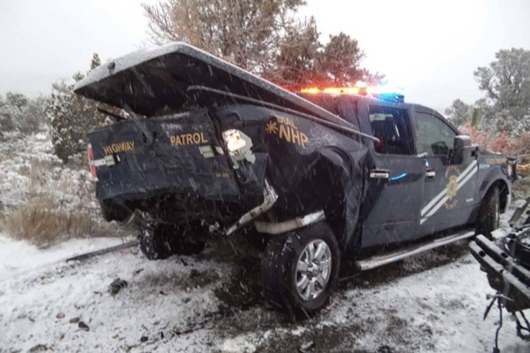 This photo shows the aftermath of a crash between a sport utility vehicle and a state trooper v ...