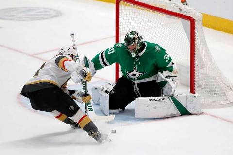 Dallas Stars goaltender Ben Bishop (30) makes a save against a shot from Vegas Golden Knights c ...