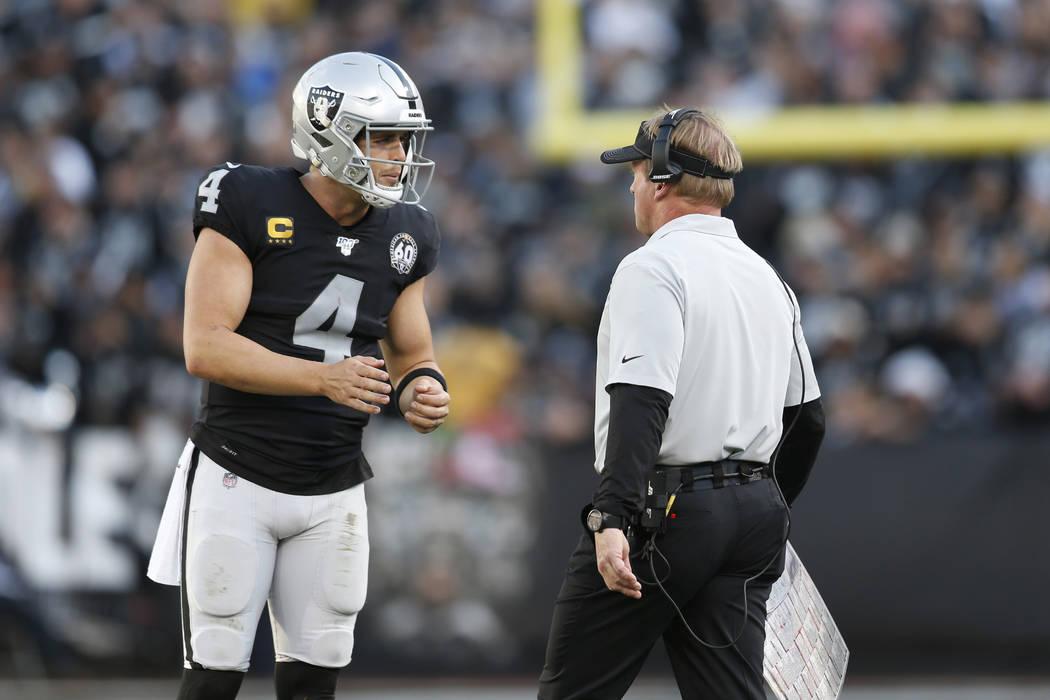 Oakland Raiders quarterback Derek Carr (4) talks with head coach Jon Gruden during the second h ...