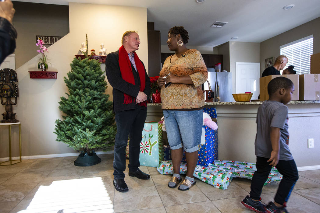Lucille McKnight, right, talks with Walker Furniture CEO Larry Alterwitz in her home in Las Veg ...