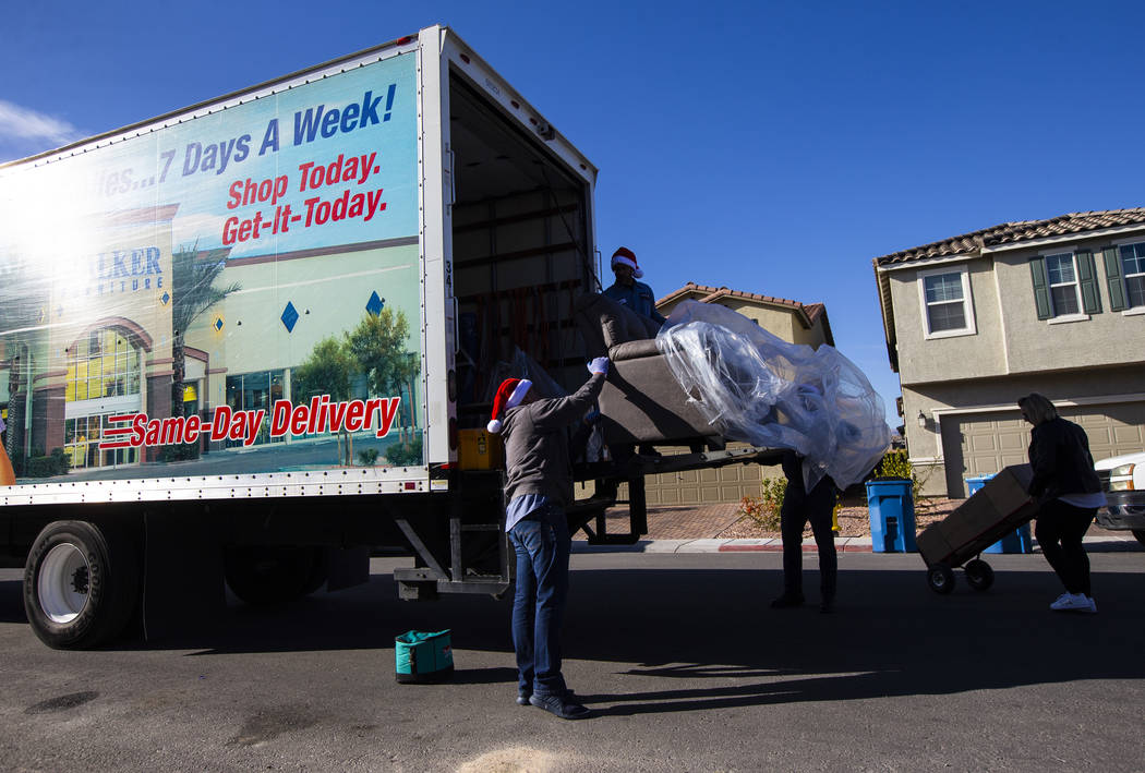 Employees from Walker Furniture deliver a truckload of furnishings for Lucille McKnight and her ...