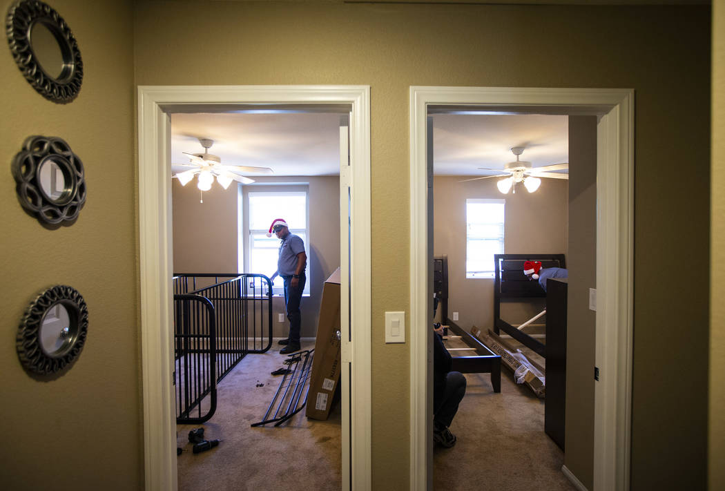 Walker Furniture employee Cole, who declined to give his last name, helps set up furnishings fo ...
