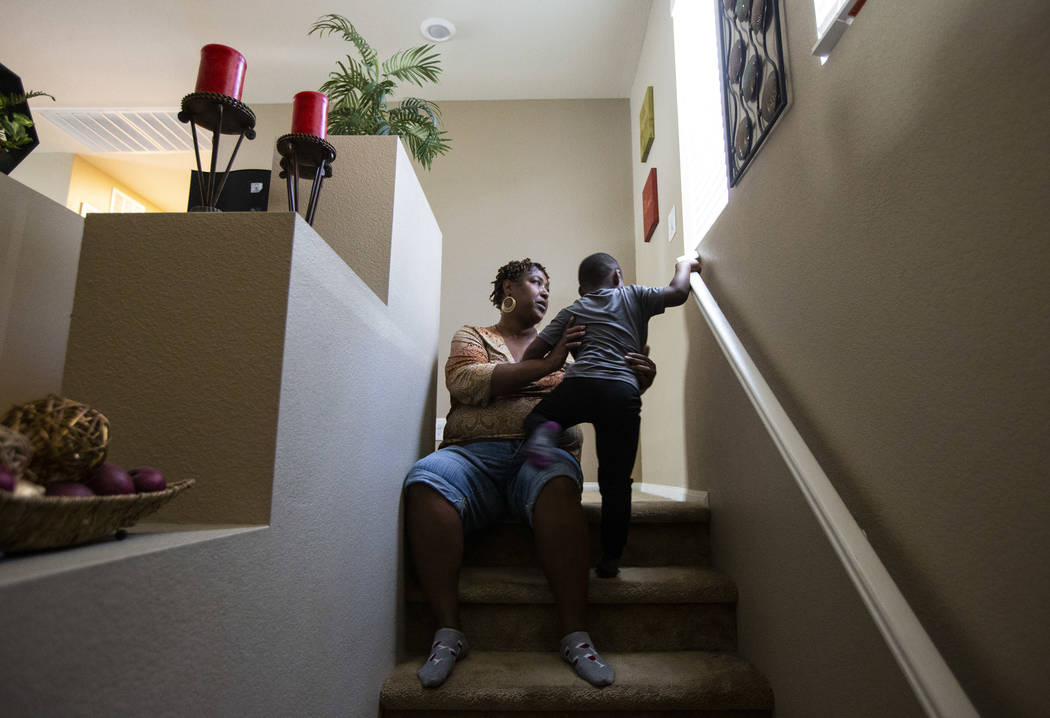Lucille McKnight sits for a moment with her great-nephew, Noel Modica, 4, as employees from Wal ...