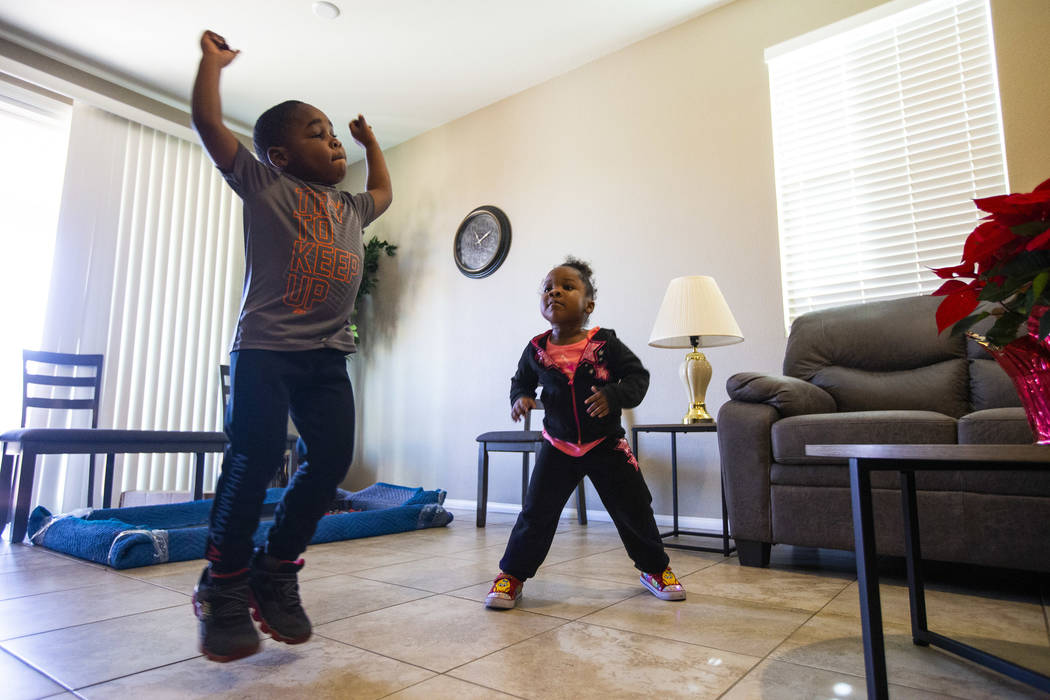 Noel Modica, 4, dances around the living room with his sister, Christine Modica, 3, after Walke ...