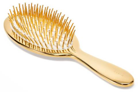 Handcrafted in Italy, AERIN's classic hairbrush features gold-tipped ivory bristles. aerin.com