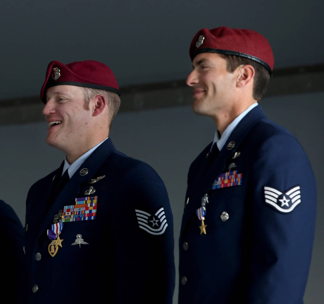 Recipient of the Purple Heart and Silver Star Medal Technical Sgt. Gavin Fisher, left, and reci ...