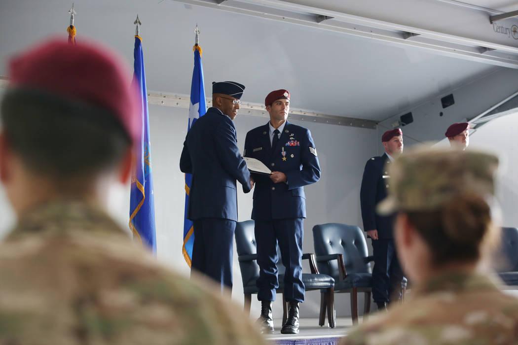 Gen. Charles Brown Jr., left, and Staff Sgt. Daniel Swensen hold Sgt. Swensen's certificate of ...