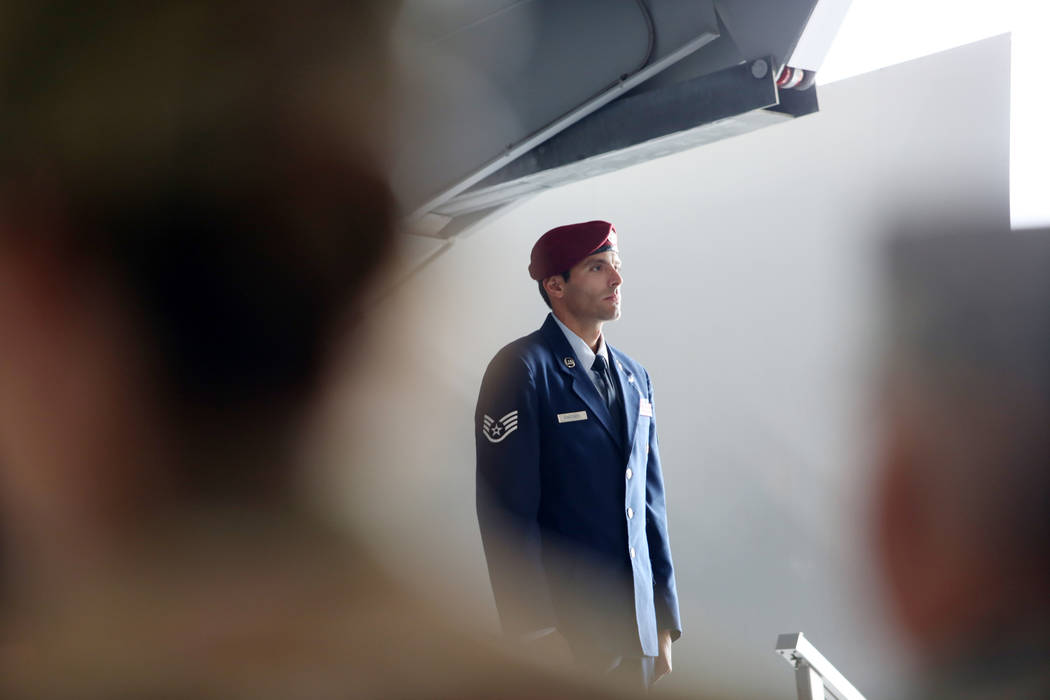 Staff Sgt. Daniel Swensen stands during a ceremony awarding the Silver Star Medal to Technical ...