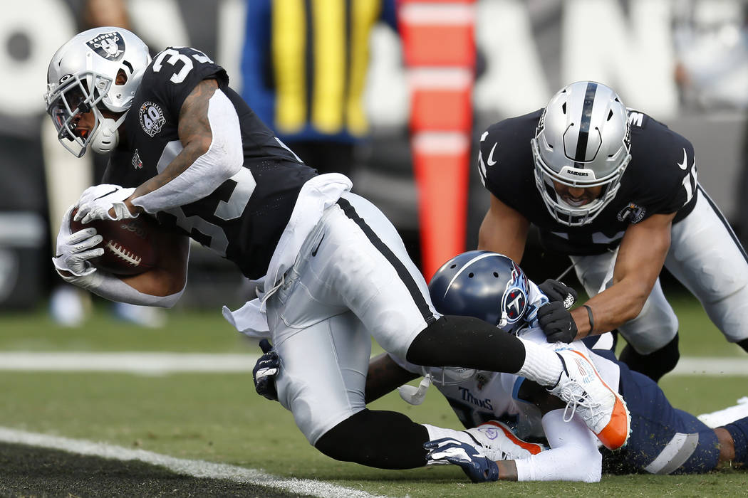 Oakland Raiders running back DeAndre Washington (33) scores a touchdown past Tennessee Titans d ...
