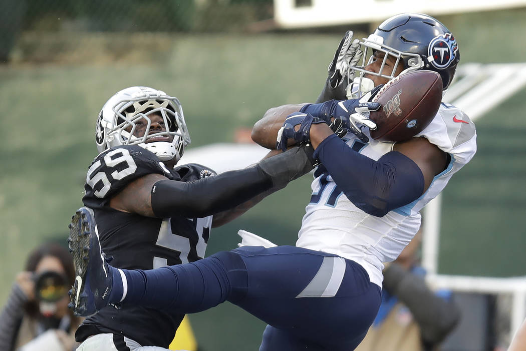 Tennessee Titans tight end Jonnu Smith, right, catches a touchdown pass against Oakland Raiders ...