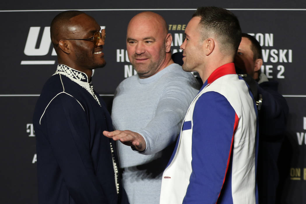 UFC welterweights Kamaru Usman, left, and Colby Covington, right, engage in a faceoff as UFC pr ...