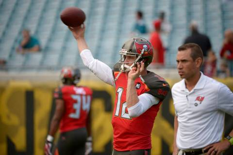 Tampa Bay Buccaneers quarterback Josh McCown (12) warms up as quarterbacks coach Marcus Arroyo, ...