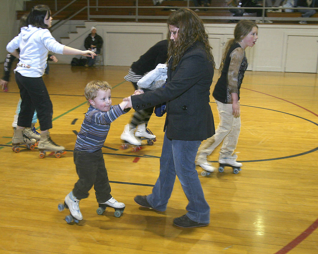 Mary Girard helps Joseph Mellow, 2, learn to skate during the Boulder City's First Night Festiv ...