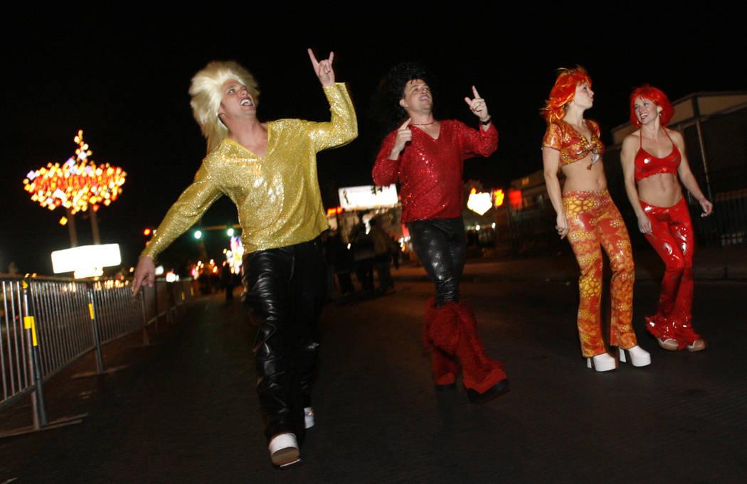 Revelers strut along the Strip on Dec. 31, 2005. (Isaac Brekken/Las Vegas Review-Journal)