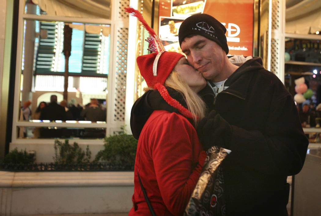 A couple embraces moments before 2011 arrives at the Fremont Street Experience in Las Vegas. (J ...