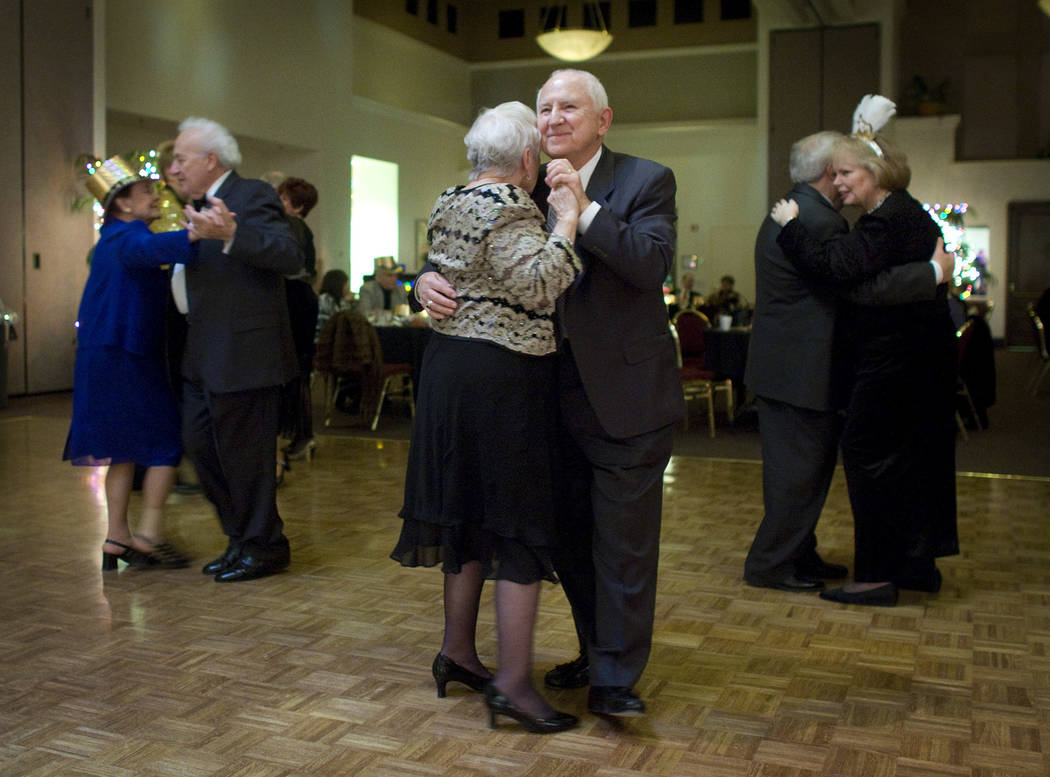 Joe Daszek dances with Midge Howell at a New Year's Eve party in Sun City Summerlin on Dec. 31, ...