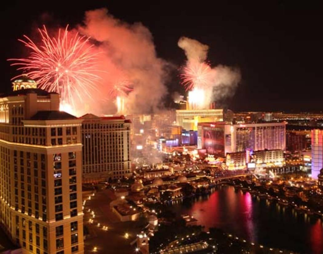 Fireworks explode over the Strip on Dec. 31, 2010. (Justin Yurkanin/Las Vegas Review-Journal)