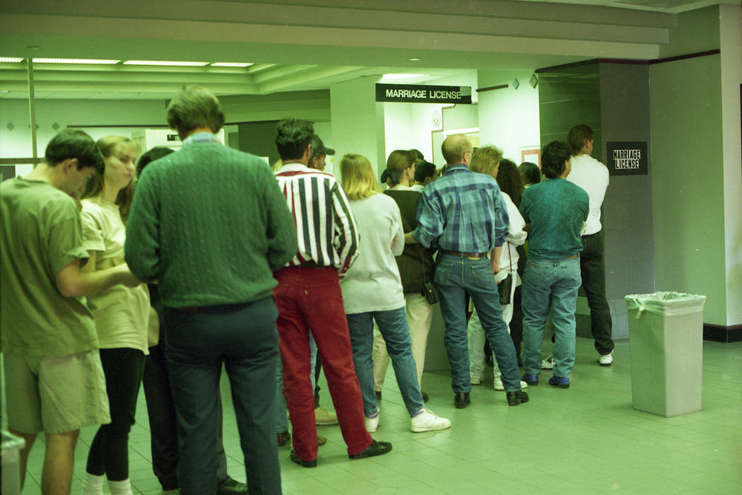 People seeking 1993 New Year's Eve nuptials stand in line at the Clark County Marriage License ...