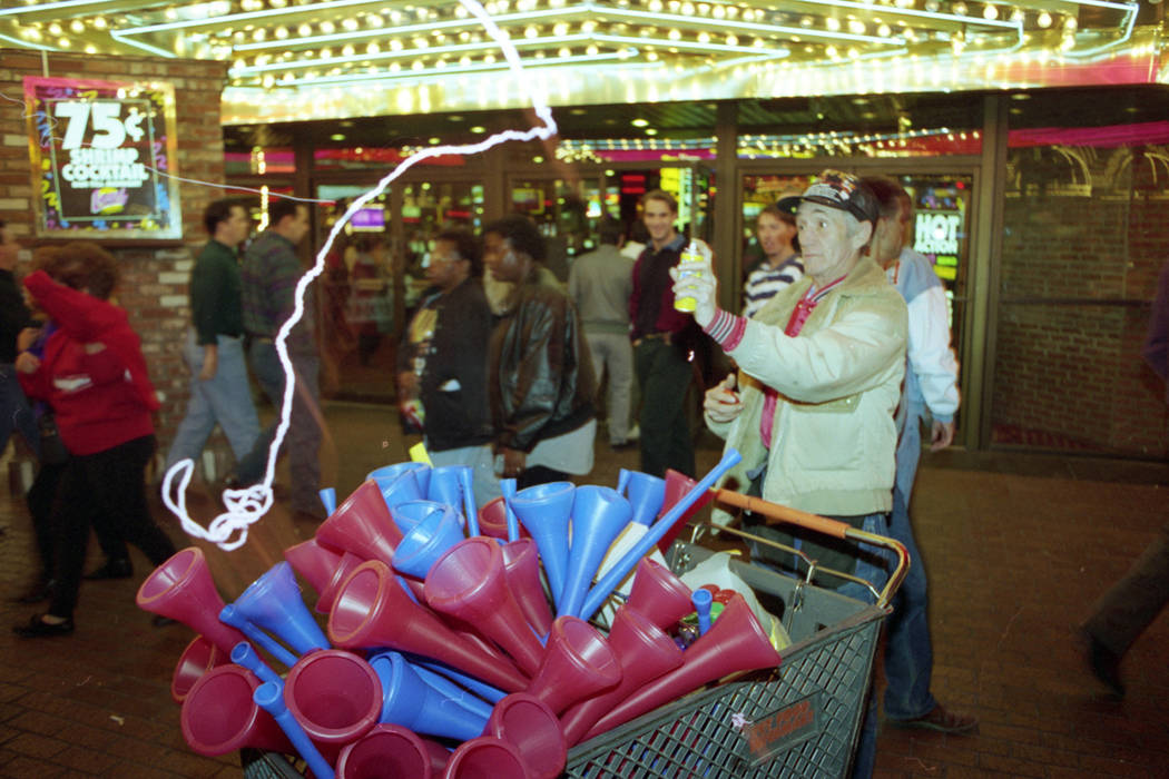 A vendor on Fremont Street sells party horns on New Year's Eve 1993. (Las Vegas Review-Journal ...