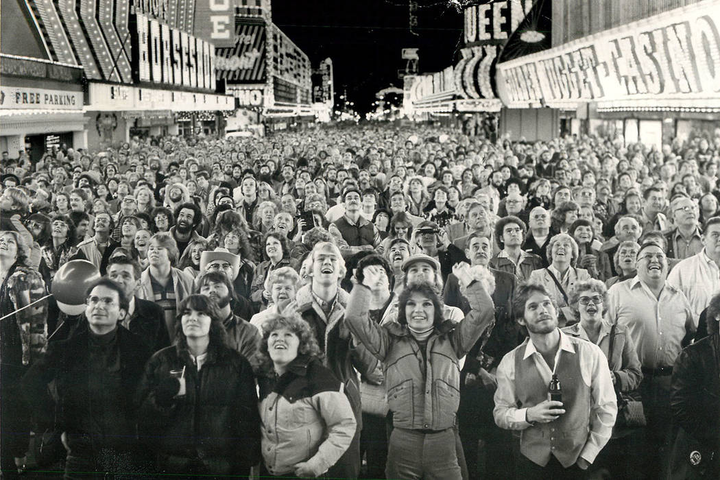 Revelers watch downtown Las Vegas fireworks on New Year's Eve 1983. (Las Vegas Review-Journal f ...