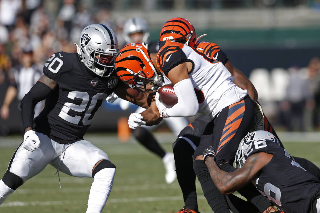 Cincinnati Bengals wide receiver Tyler Boyd is stopped with the ball by Oakland Raiders cornerb ...