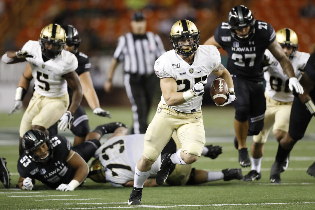 Army running back Connor Slomka (25) cuts through the Hawaii defense for a touchdown during the ...