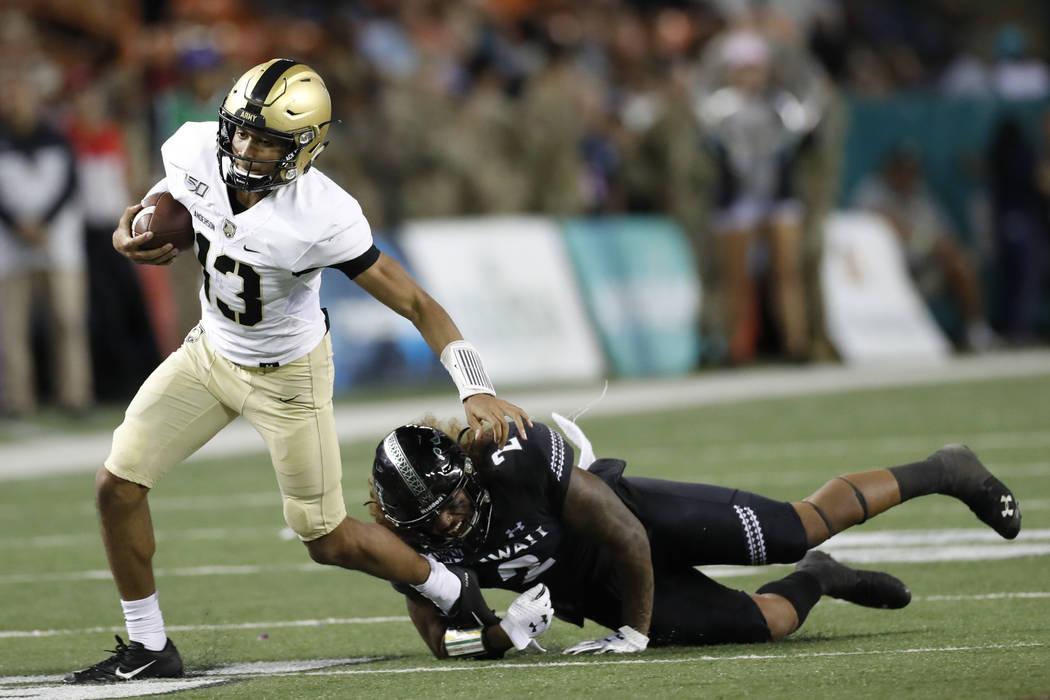 Hawaii linebacker Jeremiah Pritchard (2) tackles Army quarterback Christian Anderson (13) durin ...