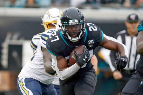 Jacksonville Jaguars running back Leonard Fournette (27) runs against the Los Angeles Chargers ...