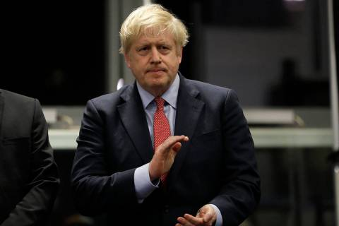 Britain's Prime Minister and Conservative Party leader Boris Johnson applauds during the Uxbrid ...
