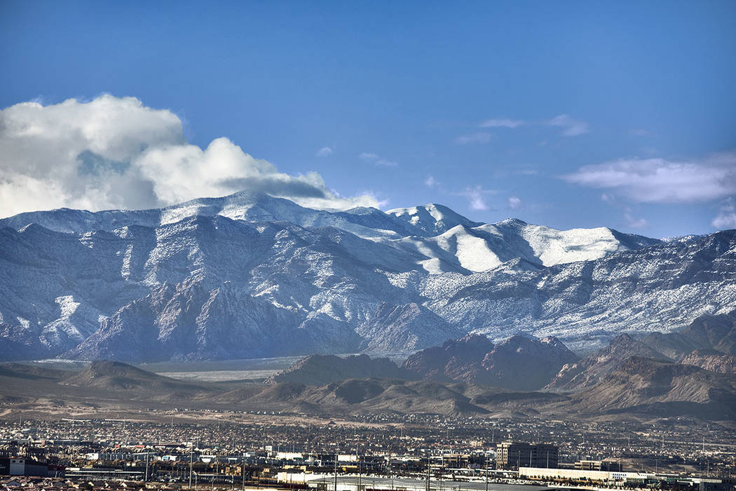 A recent view from the condo shows snow on the mountain. (One Las Vegas)
