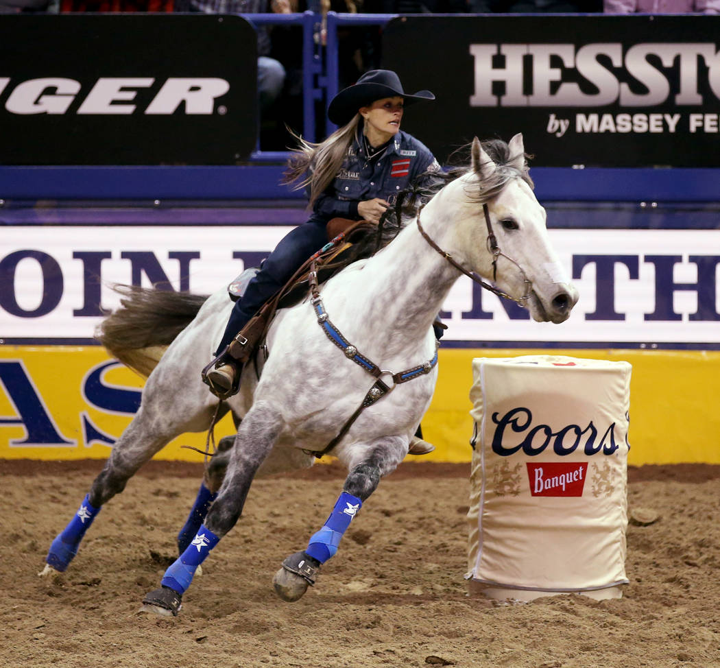 Stevi Hillman of Weatherford, Texas competes in Barrel Racing during the ninth go-around of the ...