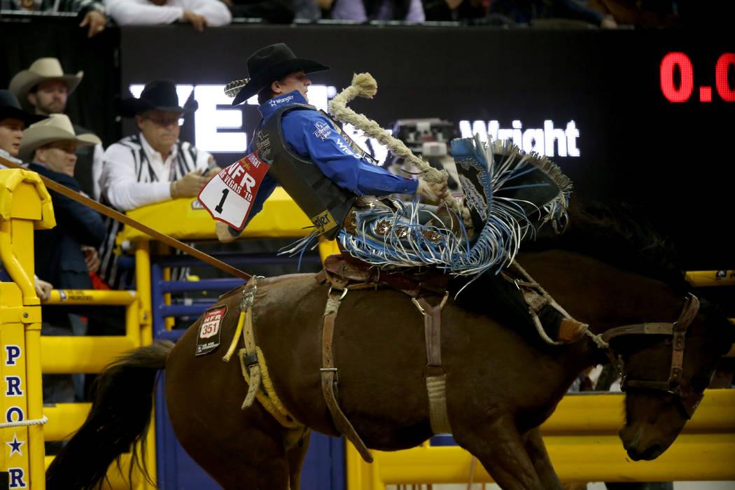 Ryder Wright of Milford, Utah rides Toma Jo in Saddle Bronc Riding during the ninth go-around o ...