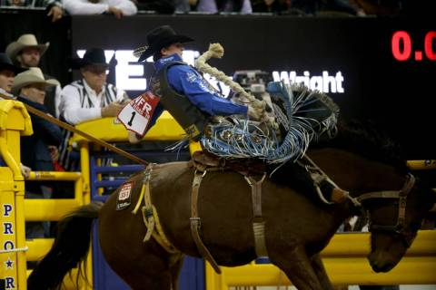 Ryder Wright of Milford, Utah rides Toma Jo in Saddle Bronc Riding during the ninth go-around o ...