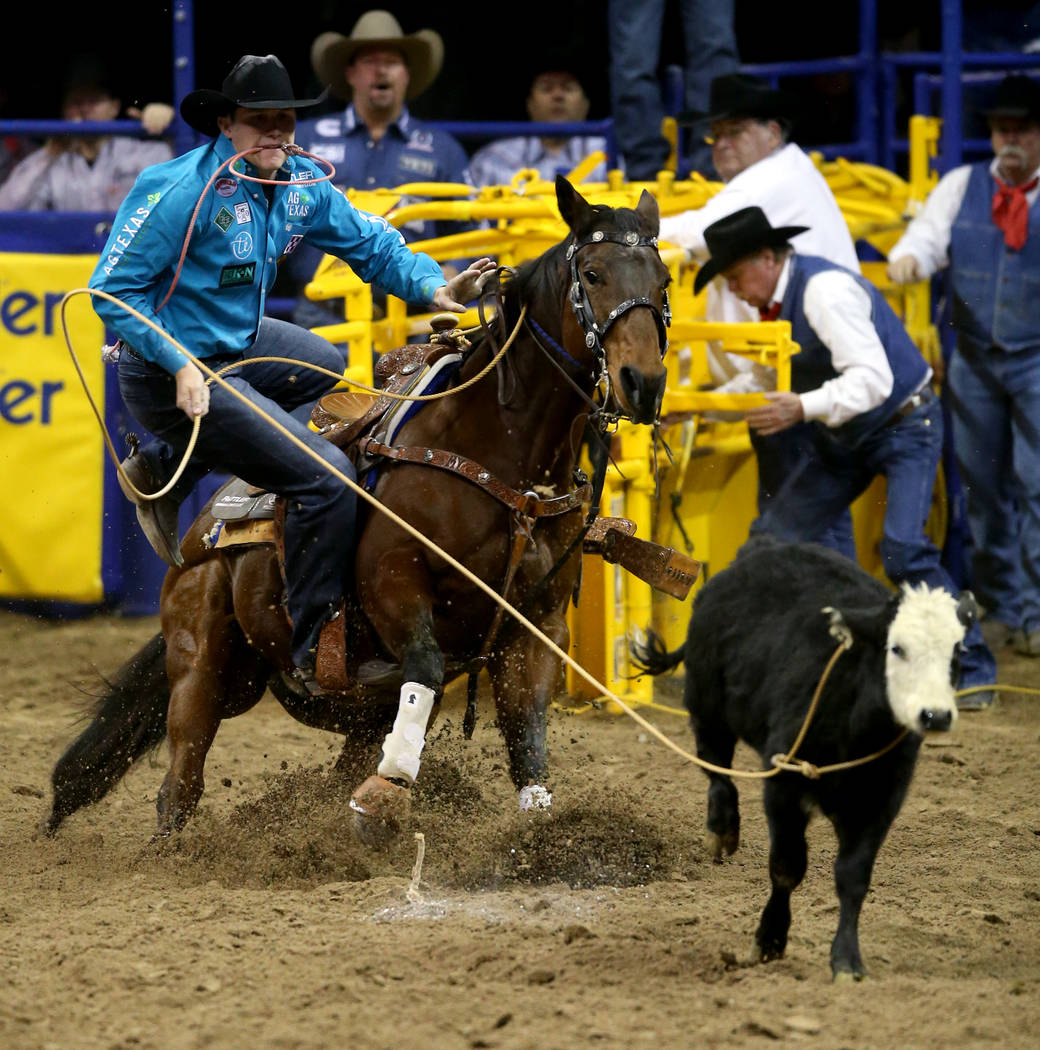 Marty Yates of Stephenville, Texas competes in Tie-Down Roping during the ninth go-around of th ...