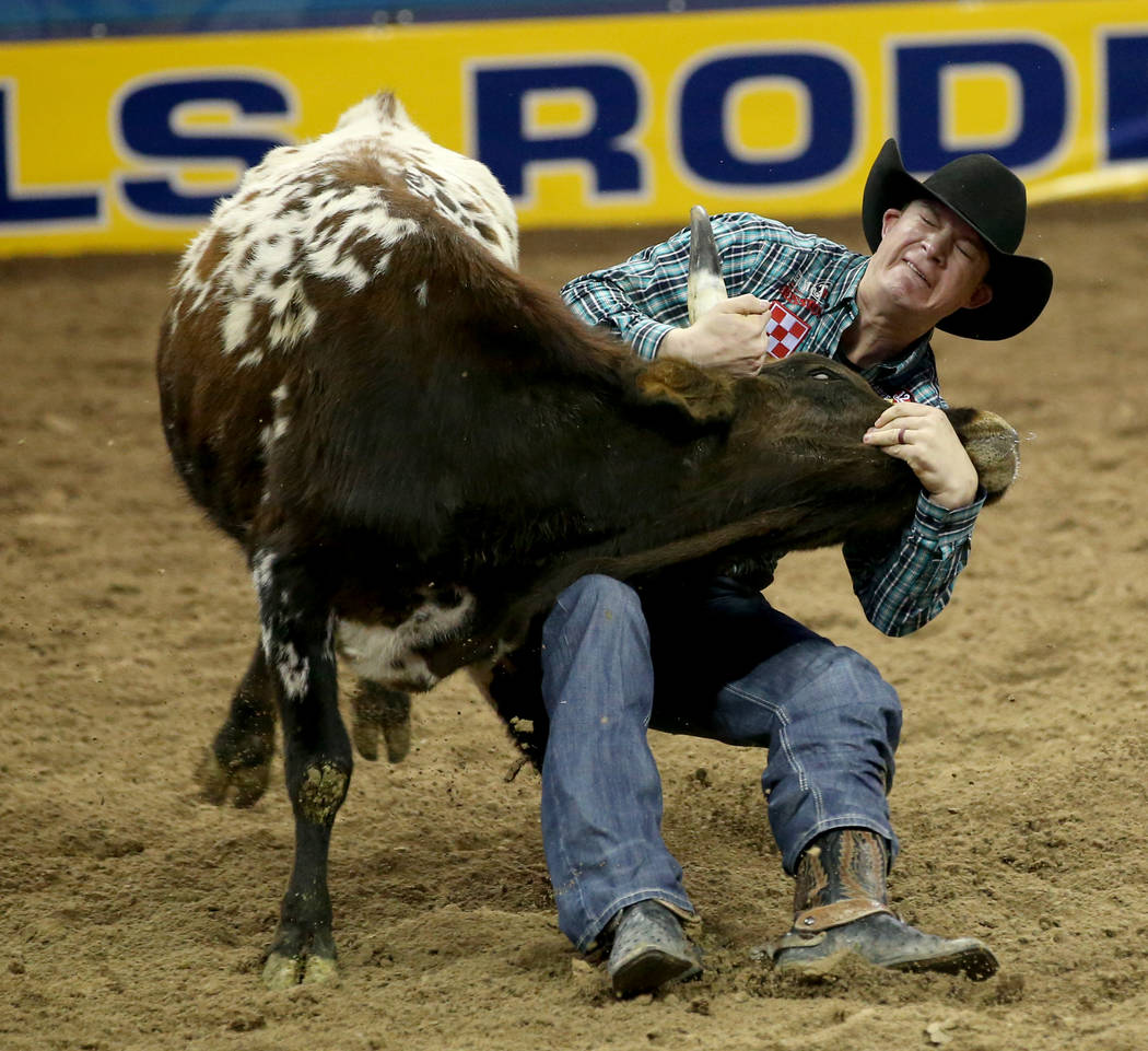 Ty Erickson of Helena, Mont. competes in Steer Wrestling during the ninth go-around of the Wran ...