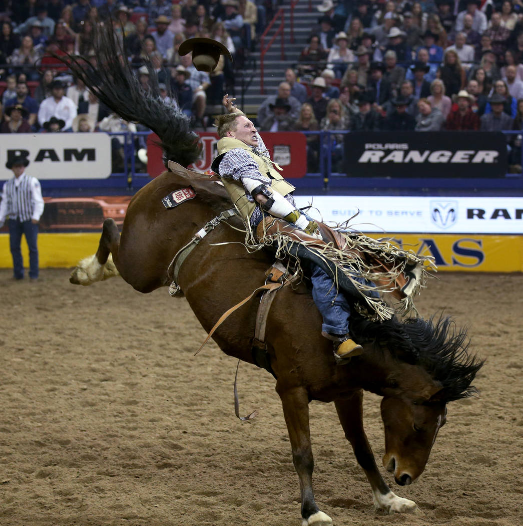 Ty Breuer of Mandan, N.D. rides Pickup Sticks in the Bareback Riding competition during the nin ...