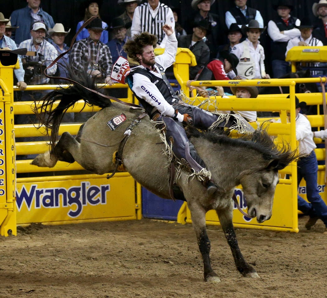 Tilden Hooper of Carthage, Texas rides Night Fist in the Bareback Riding competition during the ...